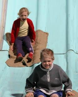 Kids on the Giant Slide Ride Giant Fibreglass Slide